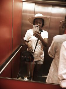 lady taking selfie in elevator