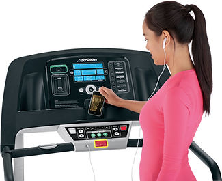 Woman connecting iphone to Life Fitness T3 console
