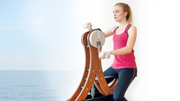 Nohrd Watergrinder with seated female model using both arms