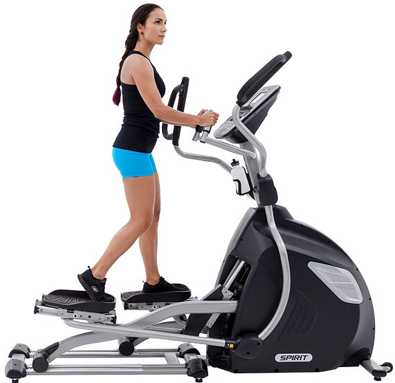 Spirit XE895 Adjustble Stride Elliptical used by woman side view