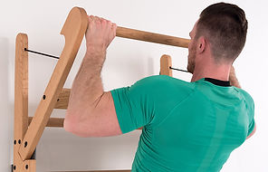 Nohrd Wallbars with mae model doing chin ups on the pivotng top bar