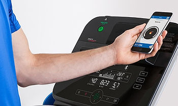 Life Fitness RS1 Recumbent Lifecycle showing man connectint iphone to console