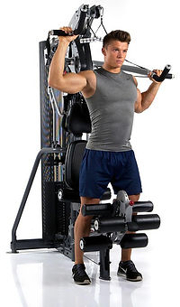 Inspire M3 Gym with male model performing standing shoulder press