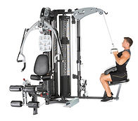 Inspire M5 home gym man doing lat pulldown