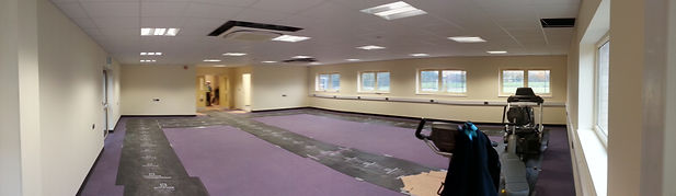 The room at John Kyrle High School before installation of fitness equipment and showing protective matting to prevent carpet damage