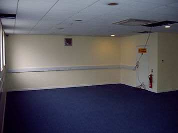 Installation of fitness equipment at Mars Food showing the empty room