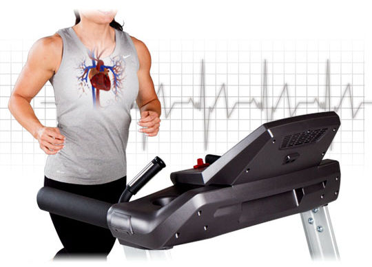 Man running on Spirit CT850ENT Treadmill showing heart rate control