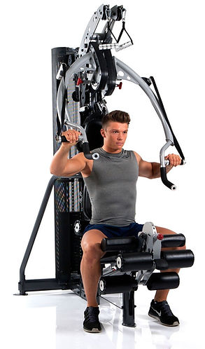 Inspire M3 home gym with man bench pressing