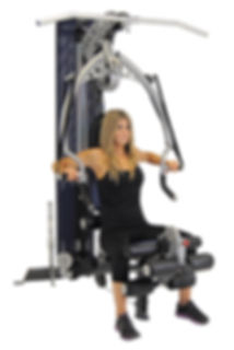Inspire M2 home gym with woman bech pressing