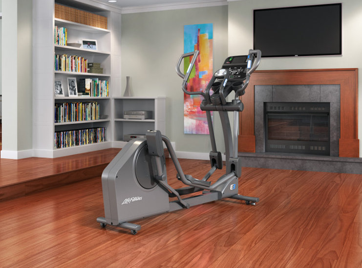 Life Fitness E3 elliptical crosstrainer on wooden floor in room