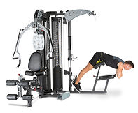 Inspire M5 home gym with man hyper extending