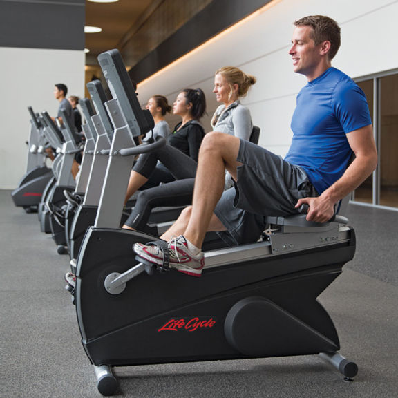 Life Fitness Club series recumbent exercise bike being used in health club