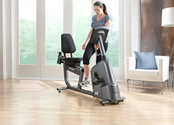 Life Fitness RS1 Recumbent Lifecycle showing woman stepping through low frame