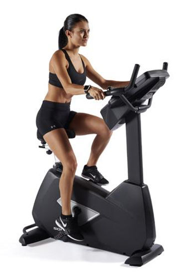 Sole LCB Upright Bike with female model