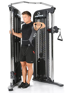 Inspire FT1 Functional Trainer with male model performing lateral raise from pulley in low position