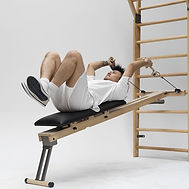 Nohrd Wallbars with male model using optional padded bench