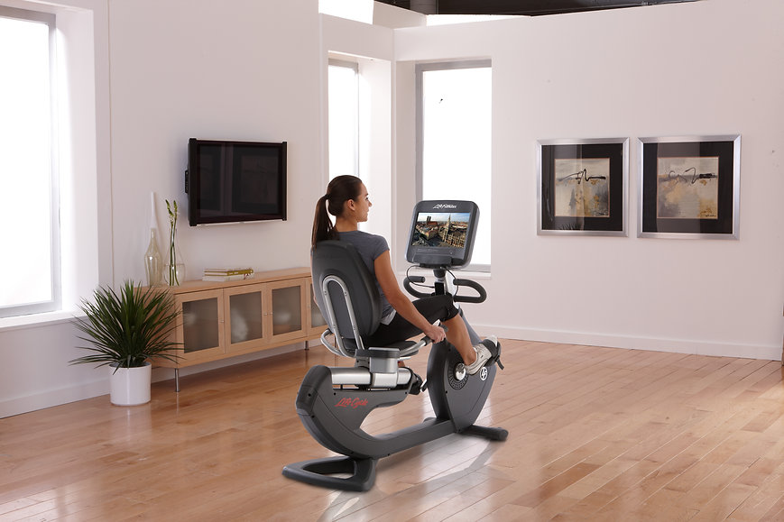 Life Fitness Platinum Club recumbent Lifecycle bike being used by woman in stylish room