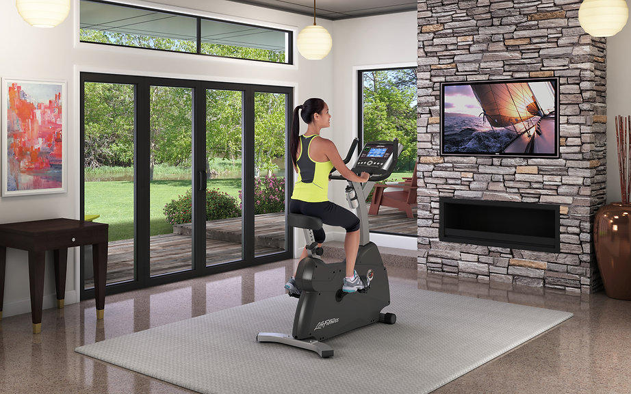 Life Fitness C1 Upright Lifecycle exericise bike in room being used by a woman
