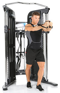 Inspire FT1 Functional Trainer with male model performing standing pec fly from pulleys in mid position
