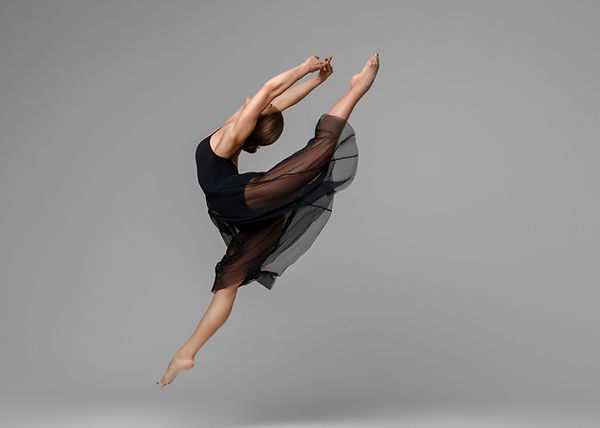 Ballet dancer woman black dress on gray
