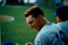 Jon Palmieri laughing with basball teammates