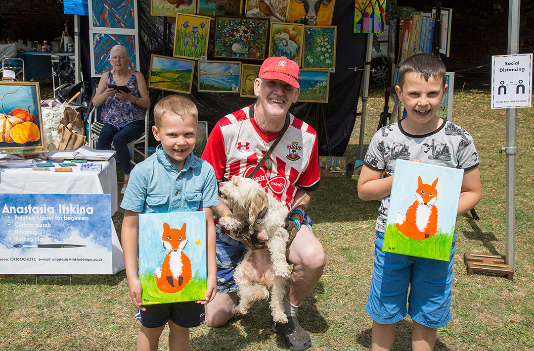 Very happy boys and visitor with his assistance dog enjoying the event!