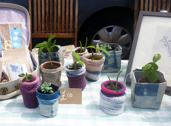 Plant pot holders designed and knitted by Harriet Bilton… very cute!