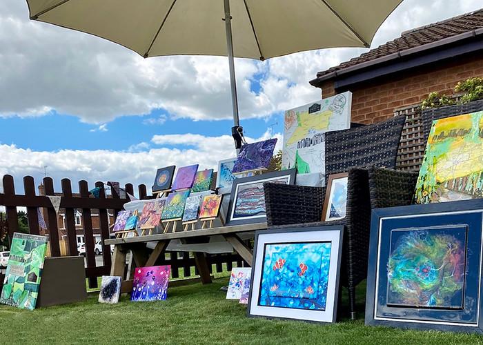 Katrina Peters' display of mix media art shaded from the sun!