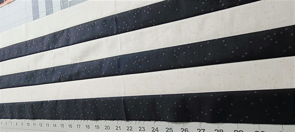 six rows of fabric sewn together alternating black and white.