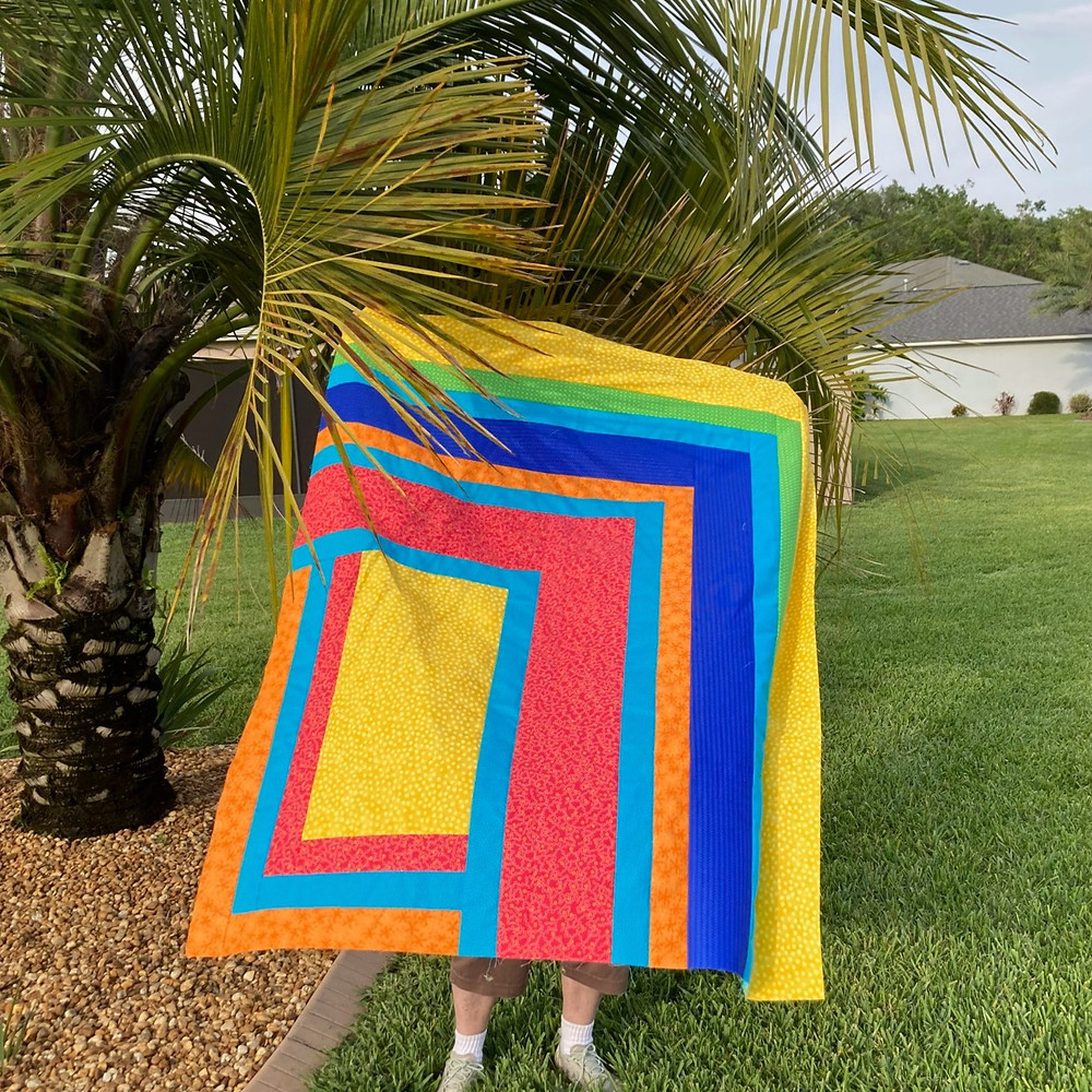 Modernized Log cabin style quilt in primary colors