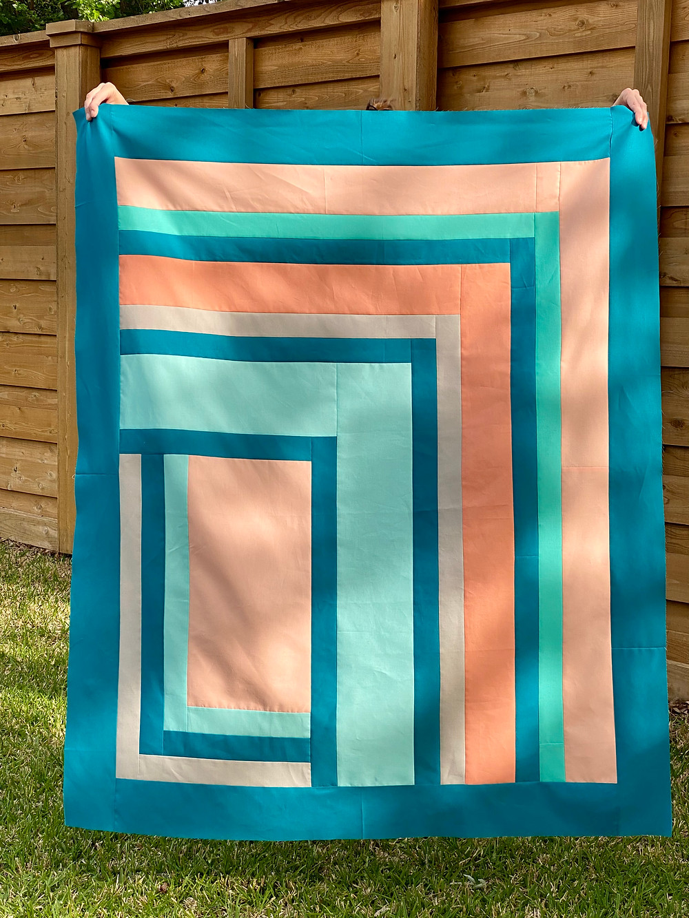 Beach inspired colors in cool hues of blue green and peach