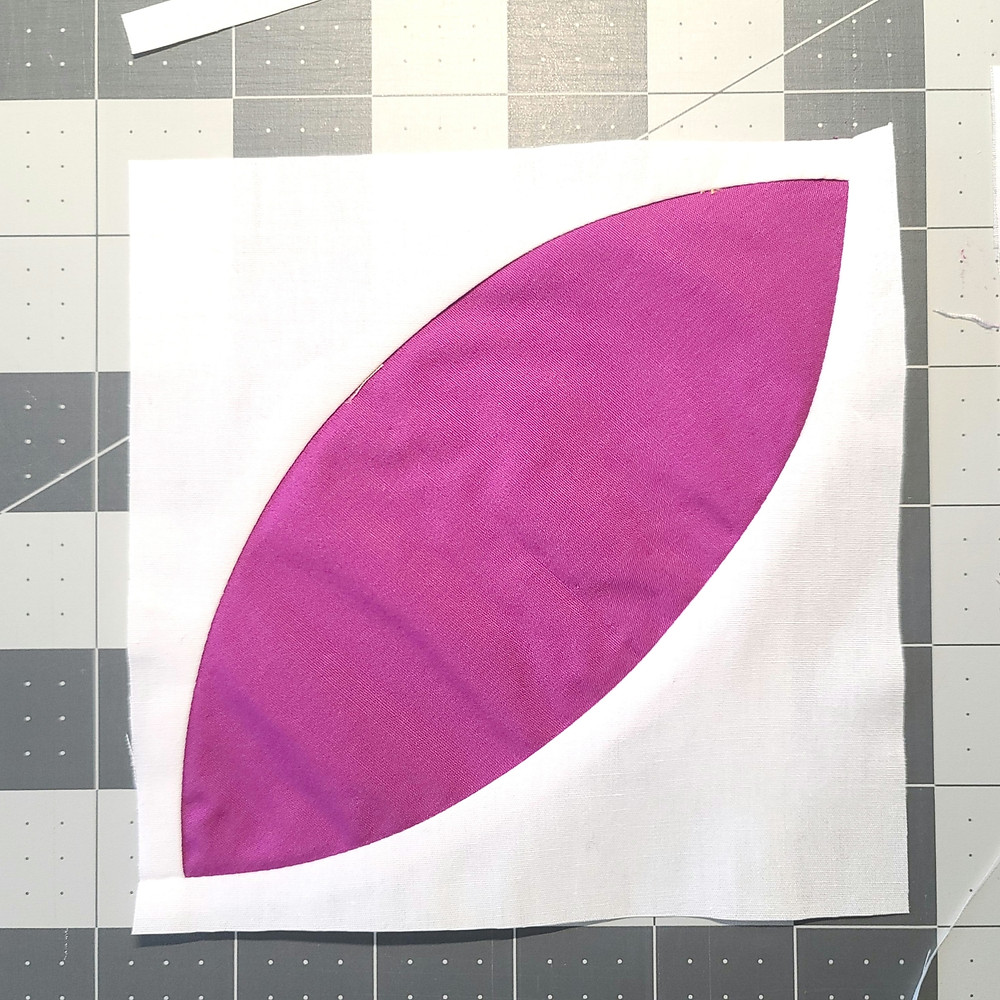 a white and purple orange peel quilt block trimmed square