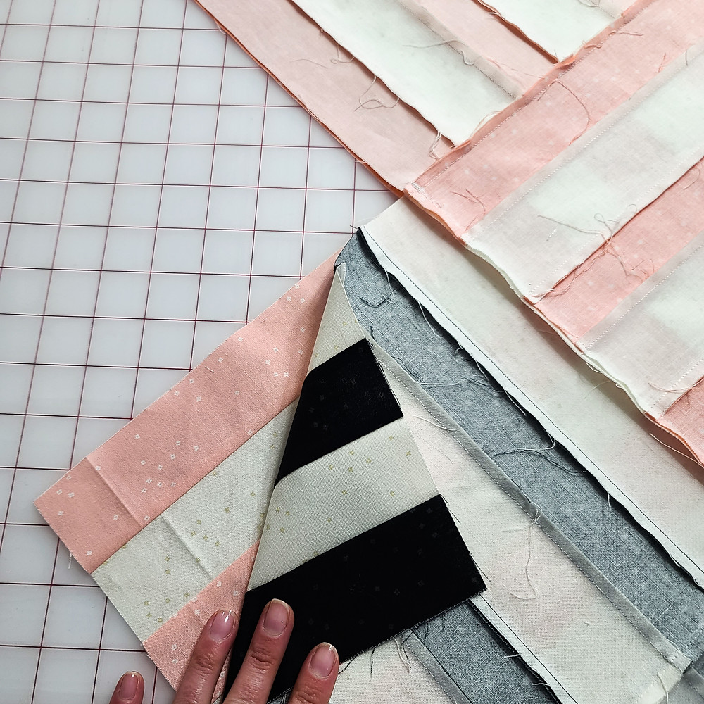 a quilt on a large cutting mat