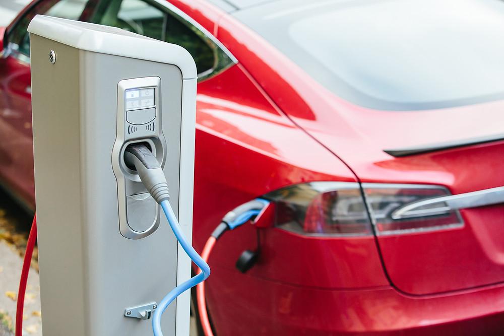 Tesla vehicle charging on outside charger