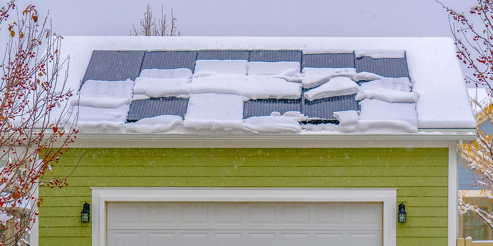 Snow on Solar Panels on home
