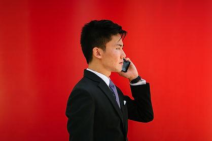 man-holding-smartphone-wearing-black-not