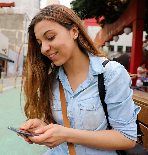 girl placing call on cell phone