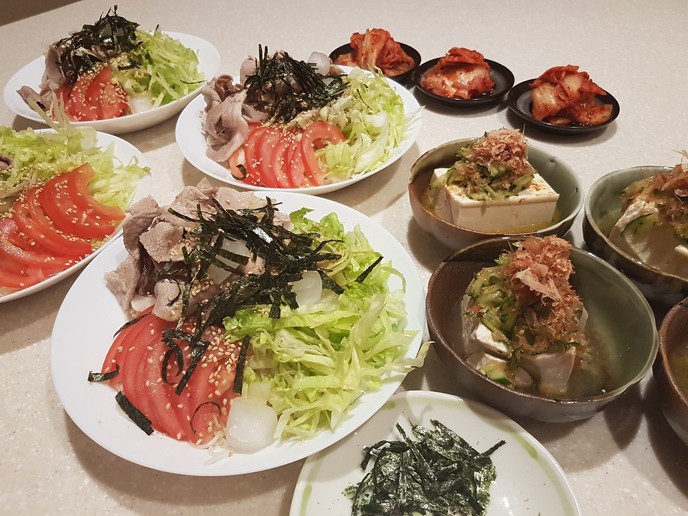 Buta shabu somment - thinly sliced pork, somen noodle, tomato, lettuce, soy-sesame sauce, lemon squeeze, dry sea-weed.    Hiyayakko - silken tofu, cucumber, Szechuan pickles, sesame, dried bonito shavings, soya-dash stock, salami oil.  Pre-made Korean Kimchi.