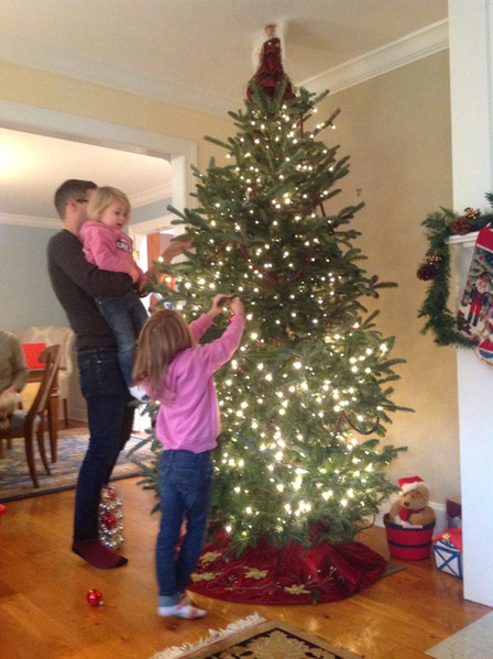 Christmas is our favorite holiday, and we always help our nieces decorate the tree. : )