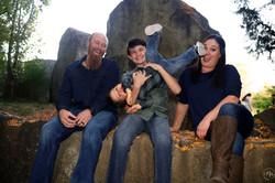 family having fun on boulder.jpg