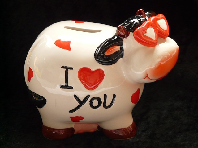 Piggybank cow covered in hearts