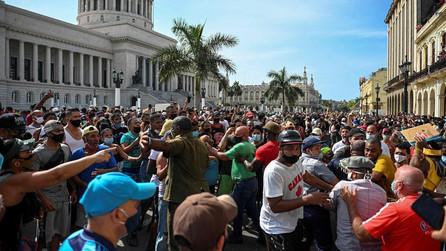 Cubans march against the government as a result of the country's economic struggles.