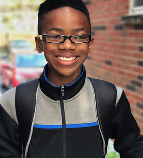 One 11-year old Boy is on a mission to interrupt the School to Prison Pipeline, One Book at a Time