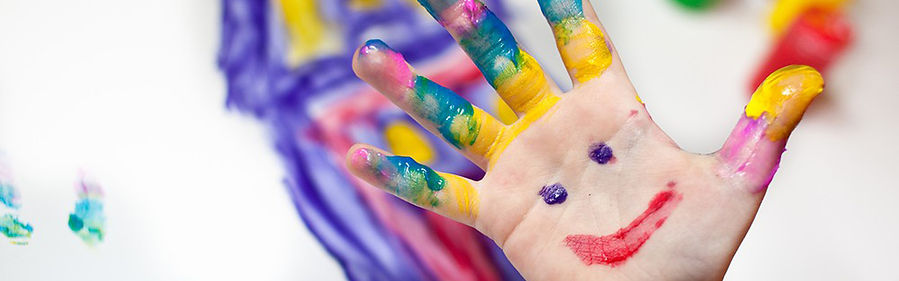 happy child hands finger paint