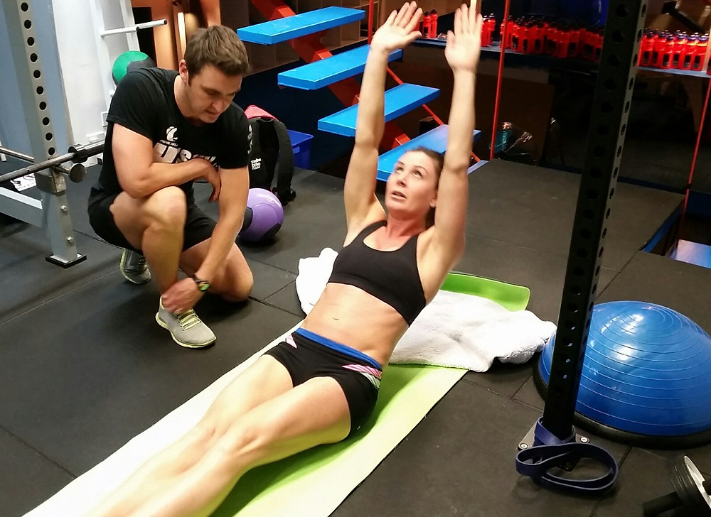 Strong girl with coach and PT