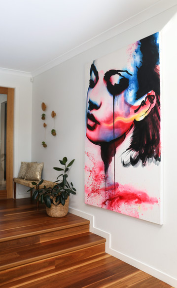 freshwater contemporary build. Entry way. Bold abstract artwork.