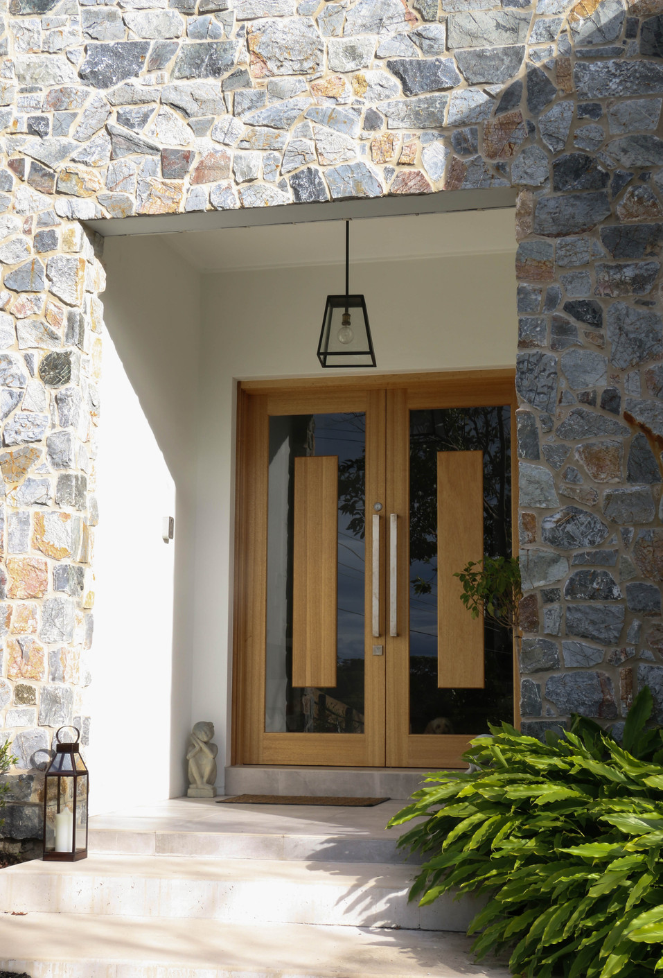 freshwater front porch - timber glass door, grey stone facade