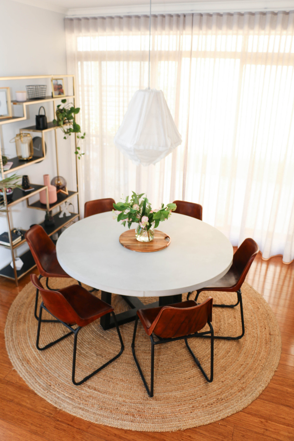 manly modern industrial dining room - concrete table, leather chairs