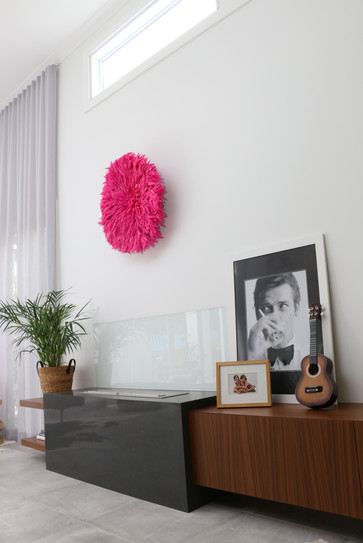 Freshwater - contemporary living room with timber cabinetry and bioethanol fireplace. Pink JuJu wall decor.