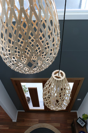 Freshwater - contemporary/industrial - Entrance hall with David Trubridge pendant lights.